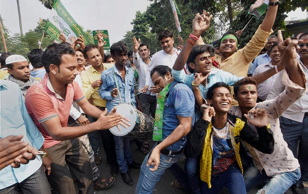 Supporters dance as they celebrate the Mahagathbandhans (Grand Alliance) victory in Bihar assembly elections in Patna.