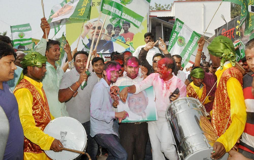 (U) supporters celebrate the Mahagathbandhans victory in Bihar assembly elections in Patna.
