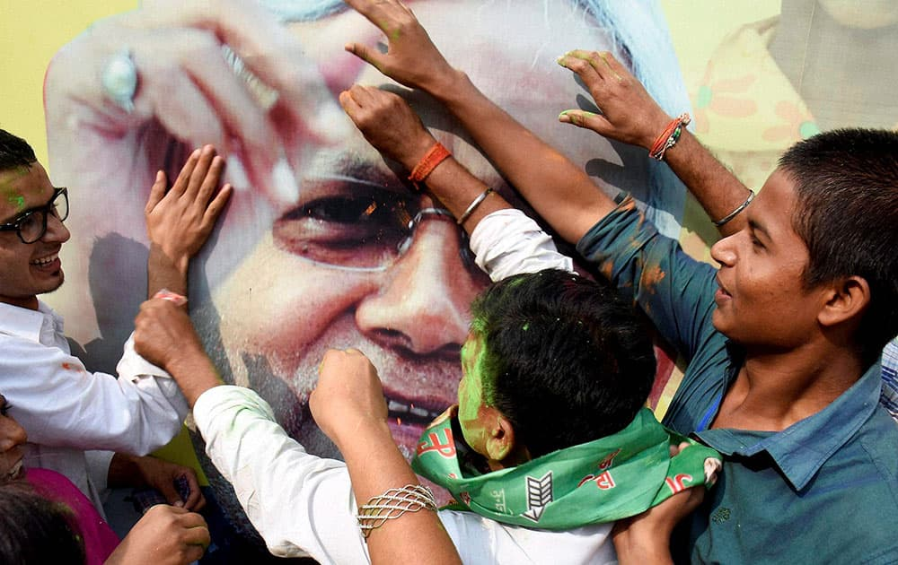 JD(U) supporters celebrate the Mahagathbandhans victory in Bihar assembly elections in Patna.