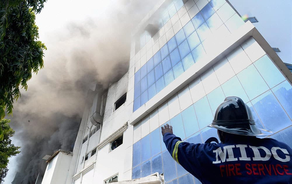 Smoke billowing out after a fire at a chemical factory in Navi Mumbai.