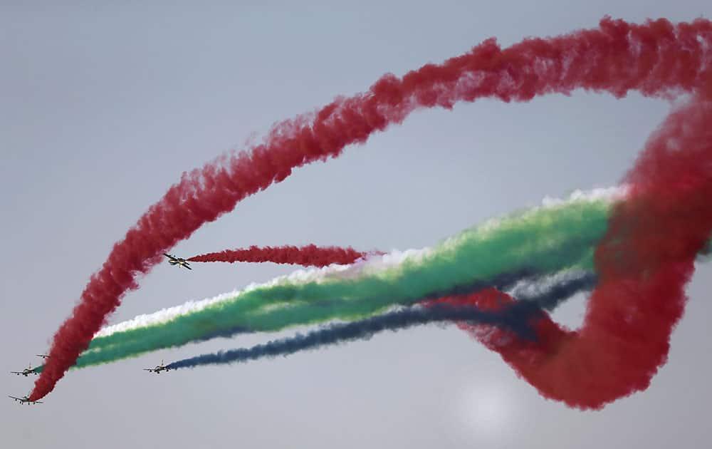 Al Fursan, the UAE Air Force aerobatic display team, perform during the opening of the Dubai Airshow in United Arab Emirates.