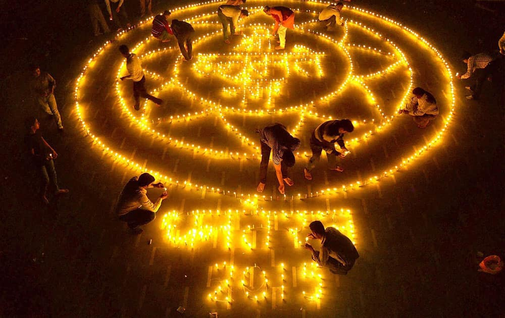 People light earthen Lamps in an artistic style on the occasion of Dhanteras ahead of Diwali festival in Moradabad.