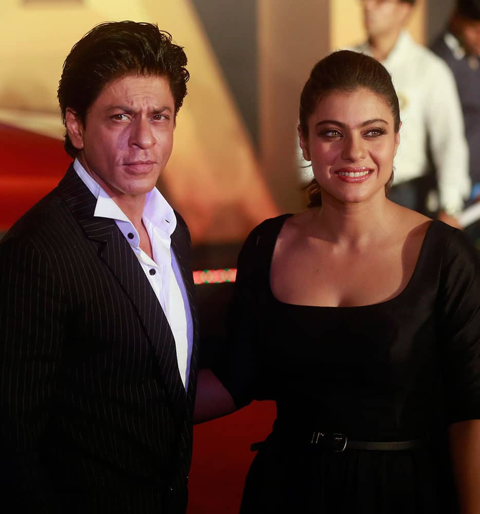 Shah Rukh Khan and Kajol pose for photos before the trailer launch of