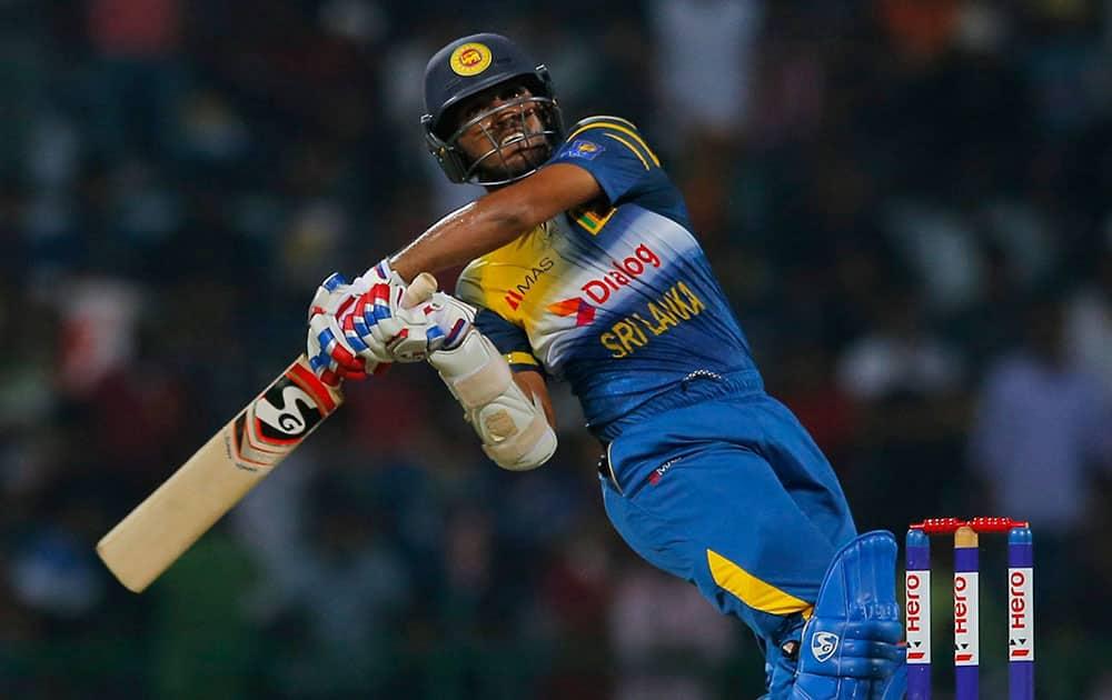Sri Lankas Shehan Jayasuriya plays a shot during their first Twenty20 cricket match against West Indies in Pallekele, Sri Lanka.