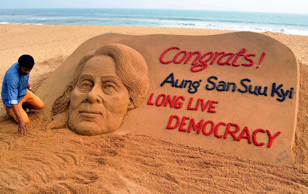 Sand artist Sudarshan Pattnaik creates a sand sculpture with a message Congrats! Aung San Suu Kyi, Long Live Democracy.