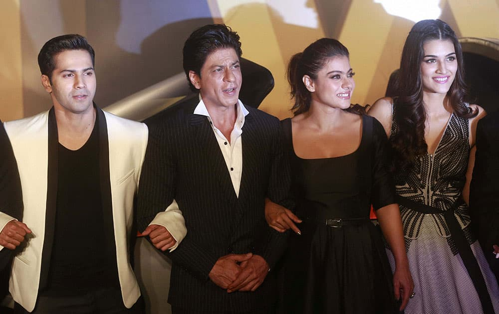 Bollywood actors Varun Dhawan, Shah Rukh Khan, Kajol and Kriti Sanon pose for photographs during the trailer launch of Dilwale, in Mumbai on Monday. The movie is scheduled to releas.