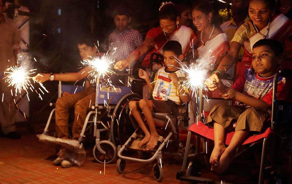 Special children celebrating Diwali festival at a school at Thane in Mumbai.