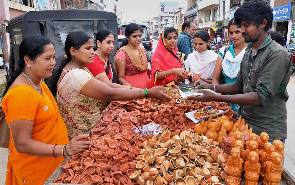 Women buying earthen lamps on ahead of Diwali festival at Chikmagalur in Karnataka.
