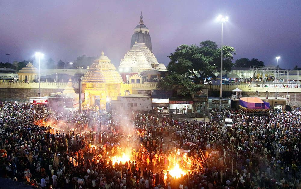 People burning jute sticks outside the Shri Jagannath temple in Puri to pay obeisances to their forefathers on the occasion of Diwali.
