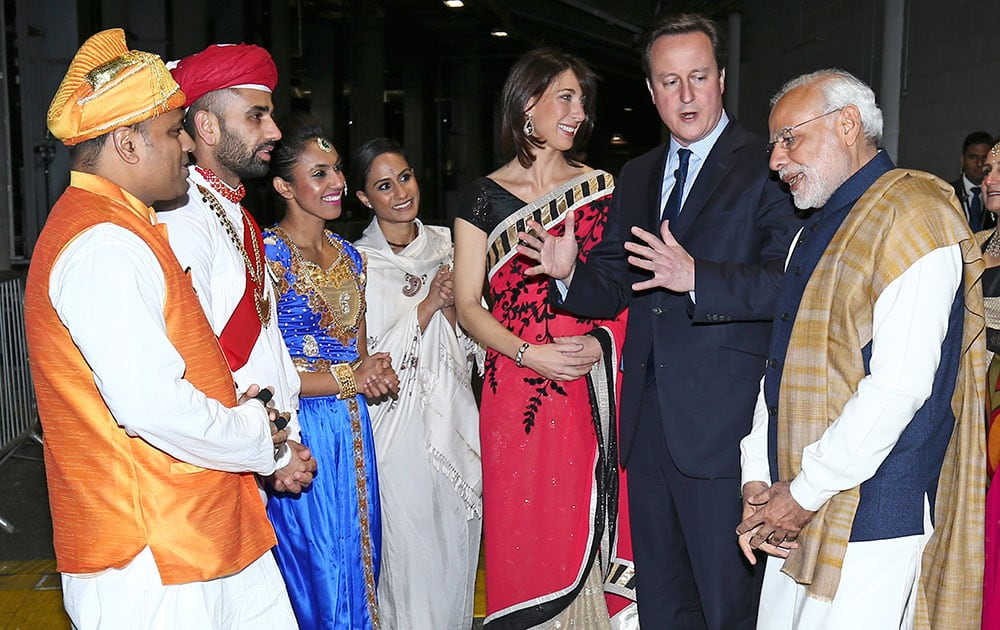 Indian Prime Minister Narendra Modi with British Prime Minister David Cameron and his wife Samantha, meet artists and performers in a backstage area at Wembley Stadium in London.