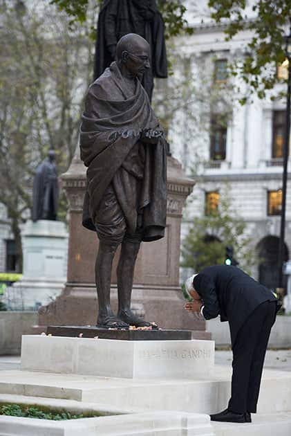 Prime Minister Narendra Modi pays homage at the statue of Mahatma Gandhi, in Parliament Square, London.