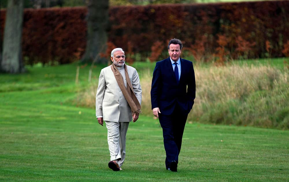 British Prime Minister David Cameron walks in the garden at his official country residence Chequers in Wendover, England, with his Indian counter-part Narendra Modi on the second day of his official visit to the UK.