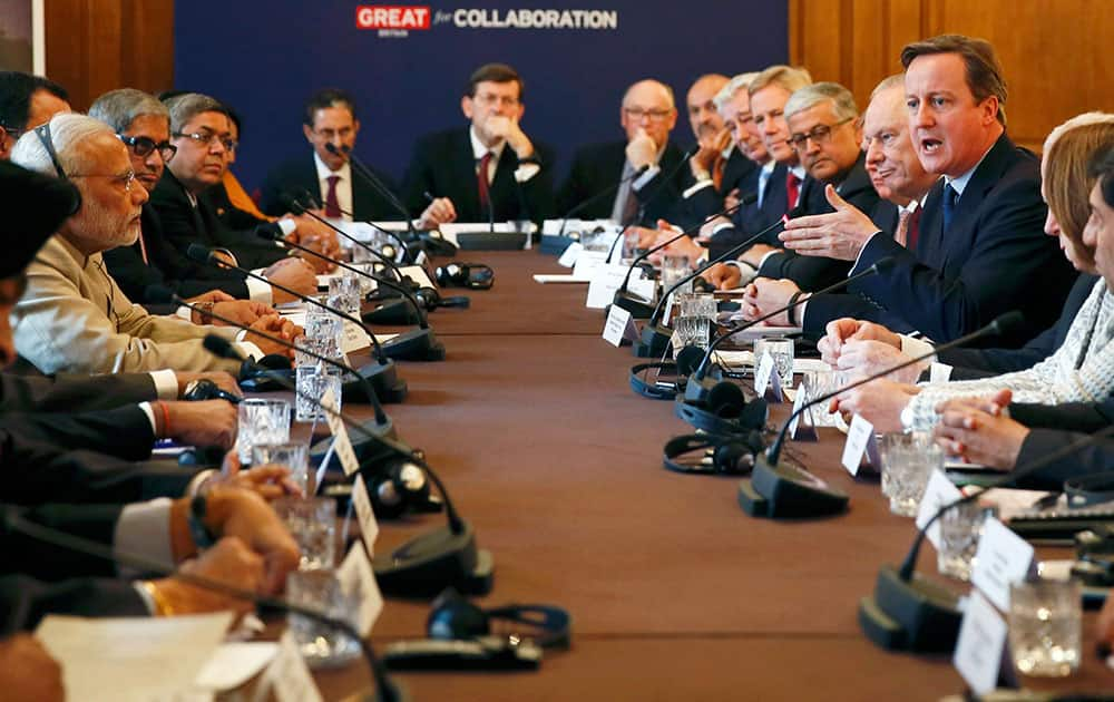 Indian Prime Minister Narendra Modi listens as Prime Minister David Cameron talks, during the CEO Forum inside 10 Downing Street in London, on the second day of his visit to the UK.