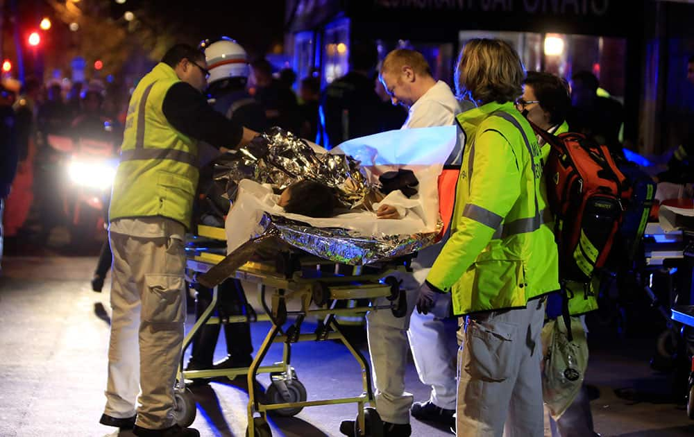 A person is being evacuated from the Bataclan theater after a shooting in Paris.