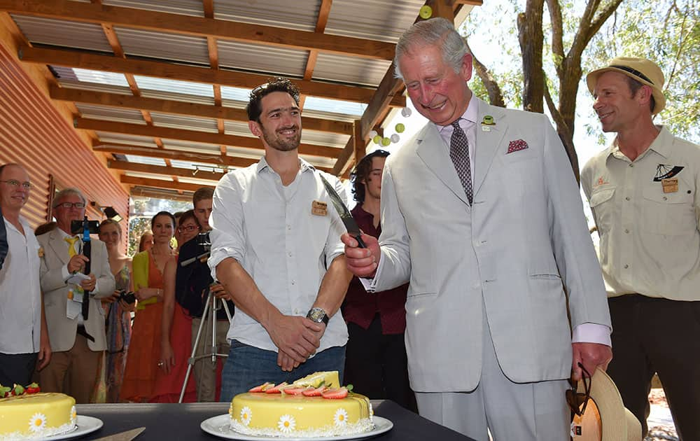 Britain's Prince Charles prepares to cut a birthday cake during a visit to Oranje Tractor Wines in Albany, Australia.