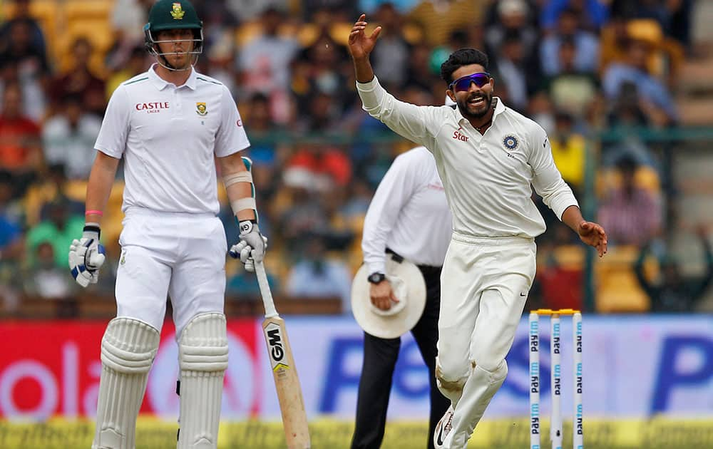 Ravindra Jadeja celebrates the dismissal of South Africa's AB de Villiers during the first day of their second cricket test match in Bangalore.