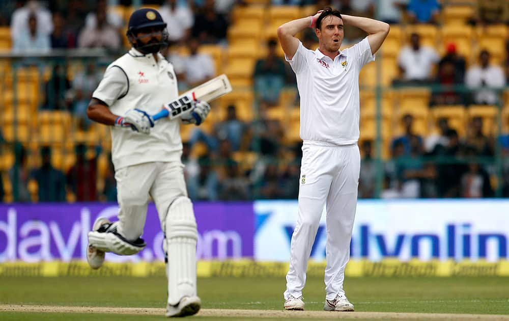 South Africa's Kyle Abbott reacts after India's Shikhar Dhawan hit a boundary on his delivery during the first day of their second cricket test match in Bangalore.