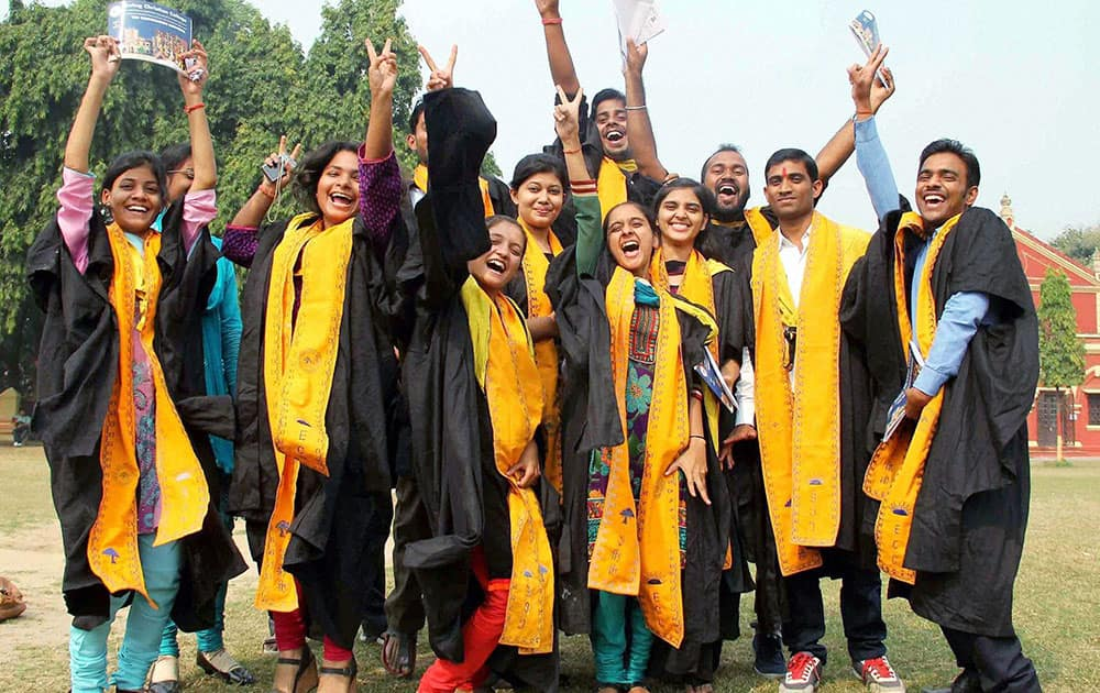 Students jubilate after receiving degree and certificates during 18th Convocation of Ewing Christian College in Allahabad.