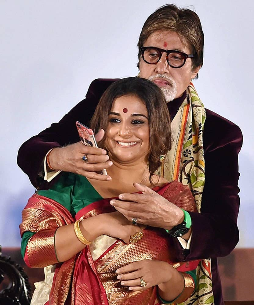 Actor Amitabh Bachchan take selfie with actress Vidya Balan during inauguration of 21st Kolkata International Film Festival in Kolkata.