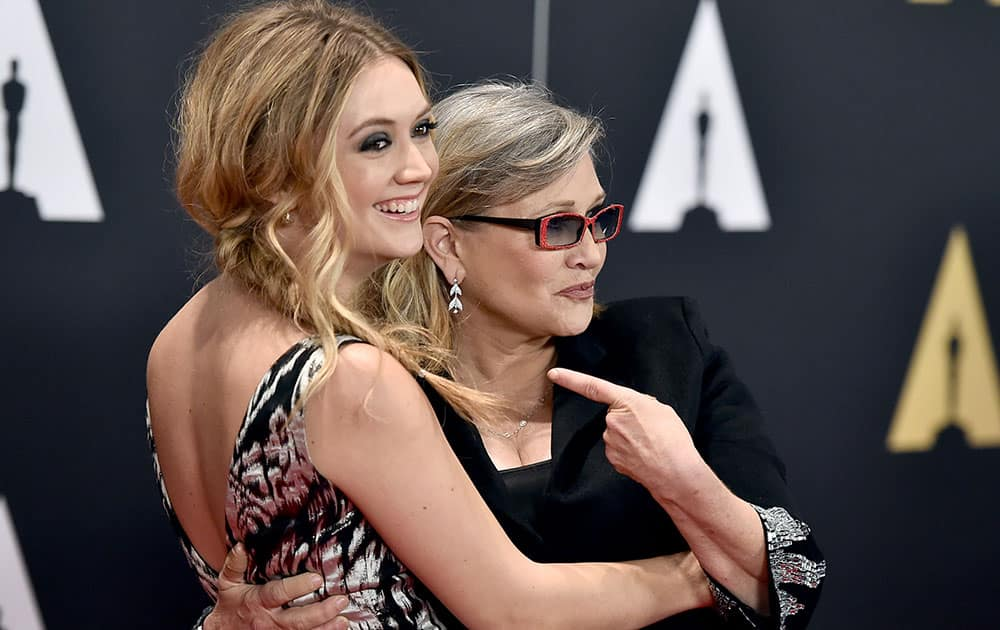 Billie Catherine Lourd, left, and Carrie Fisher arrive at the Governors Awards at the Dolby Ballroom in Los Angeles.