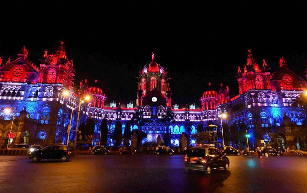 Chhatrapati Shivaji Terminus (CST) heritage building lit up in the colors of the French flag in solidarity with France after the deadly attacks in Paris, in Mumbai.