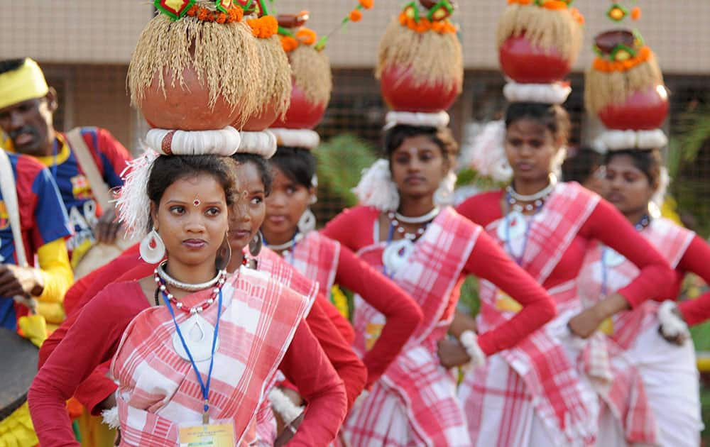 Tribal artists perform during the Jharkhands foundation day ceremony at Birsa Munda Football stadium in Ranchi.