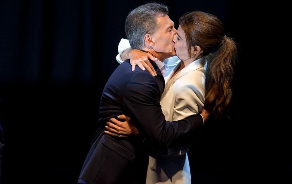 Opposition presidential candidate Mauricio Macri kisses his wife Juliana Awada at the end of the debate in Buenos Aires, Argentina.
