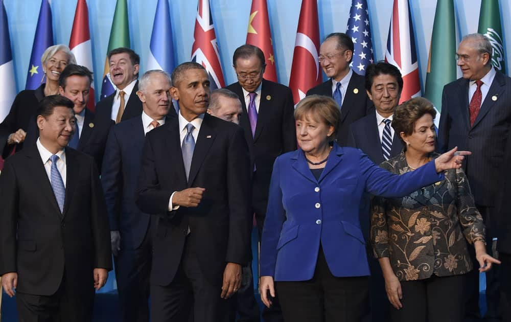 President Barack Obama walks with Germany's Chancellor Angela Merkel and other leaders as they try to figure out which way to go following the G20 Summit group photo in Antalya.