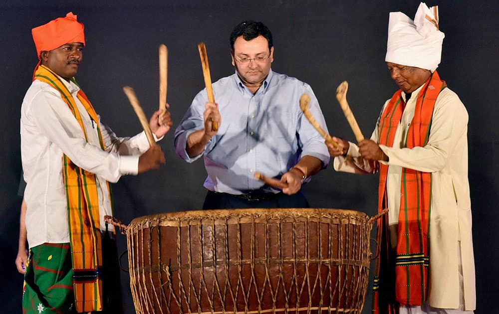 Cyrus Mistry, Chairman, Tata Group beats the Nagara (traditional drum) with traditional tribal leaders, at Samvaad – A Tribal Conclave, organised by Tata Steel in Jamshedpur.