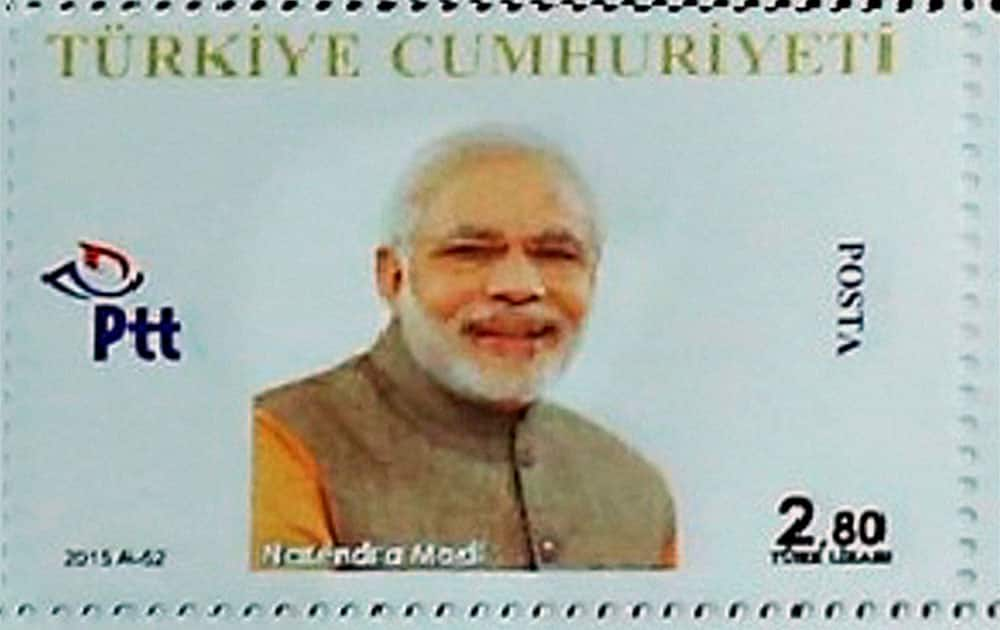Personalized stamp of Prime Minister Narendra Modi which was presented by Turkish President Recep Tayyip Erdogan (not seen) in remembrance of G20 Turkey Leaders Summit in Antalya, Turkey.