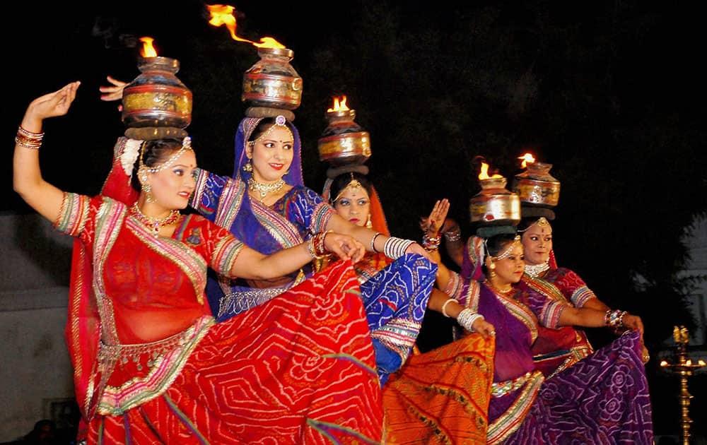 Artists perform folk dance during Mangal Milan Samaroh, at Delhi Vidhan Sabha in New Delhi.