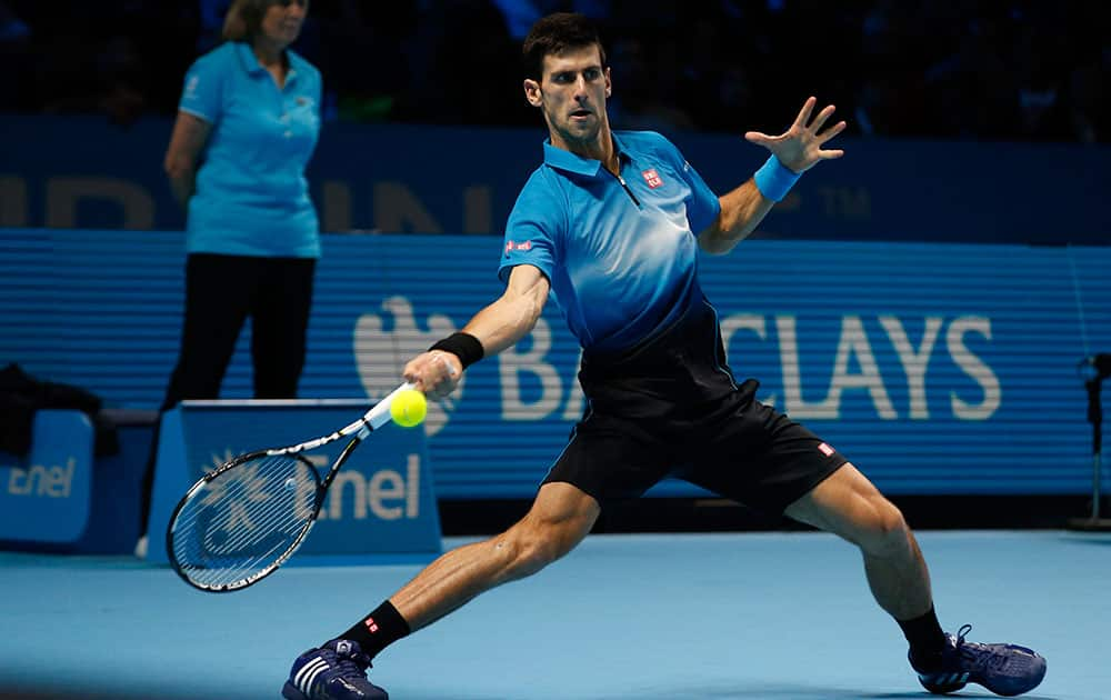 Novak Djokovic of Serbia plays a return to Tomas Berdych of the Czech Republic during their singles tennis match at the ATP World Tour Finals at the O2 Arena in London.