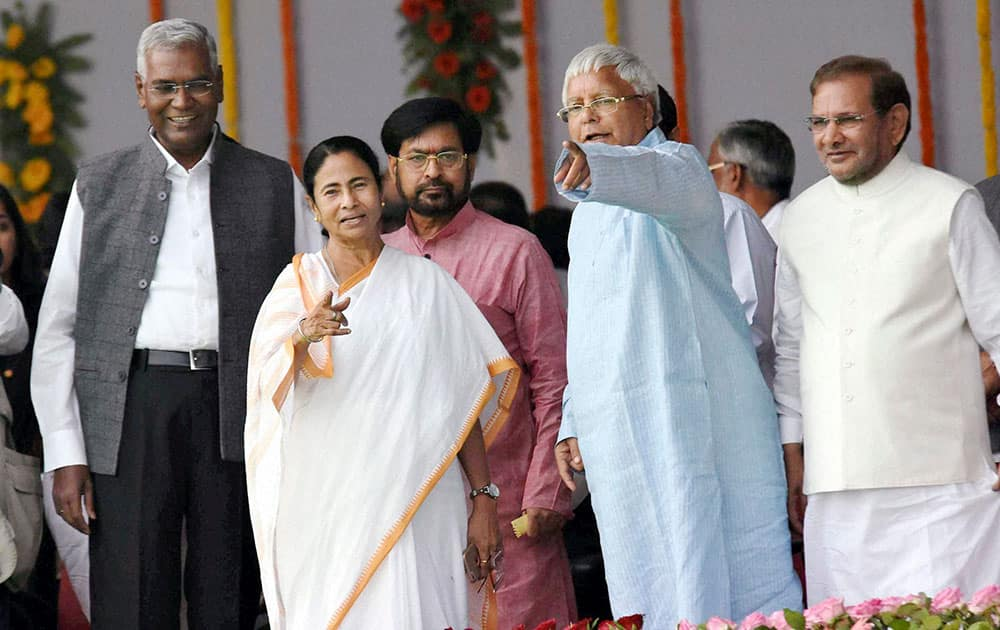 RJD chief Lalu Prasad, West Bengal Chief Minister Mamata Banerjee, JDU leader Sharad Yadav and CPI leader D. Raja during the swearing-in ceremony of the new government at Gandhi Maidan.