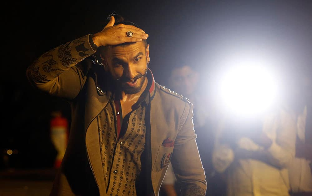 Bollywood actor Ranveer Singh dances during the trailer launch of his movie 'Bajirao Mastani' in Mumbai.