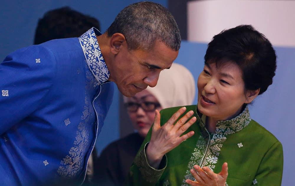 U.S. President Barack Obama, left, listen to South Korean President Park Geun-hye before the start of Gala Dinner during the ASEAN Summit in Kuala Lumpur, Malaysia.