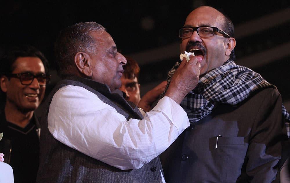 Samajwadi Party supremo Mulayam Singh Yadav with Amar Singh celebrate his 77th birthday in Saifai.
