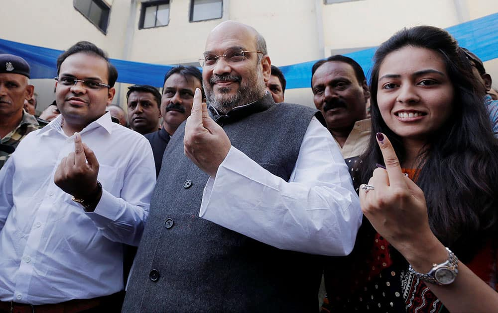 BJP President Amit Shah shows her inked finger after casting vote in Ahmedabad Municipal Corporation election at Naranpura, Ahemdabad.
