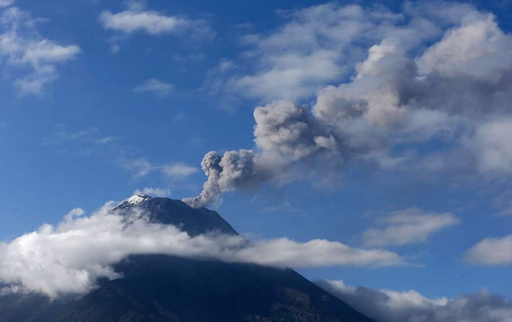 Tungurahua volcano spews ash and vapor, as seen from Ojos del Volcan, Ecuador.