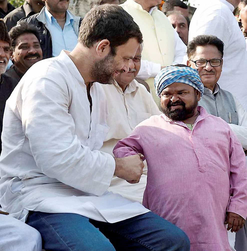 Congress Vice President Rahul Gandhi meeting with a farmer at a Chaupal during his padyatra in Saharanpur.