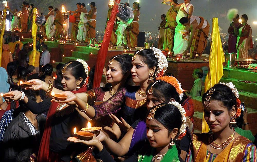 People light candles on the bank of river Ganga to celebrate Dev Diwali festival on the occasion of Kartik Poornima festival in Allahabad.