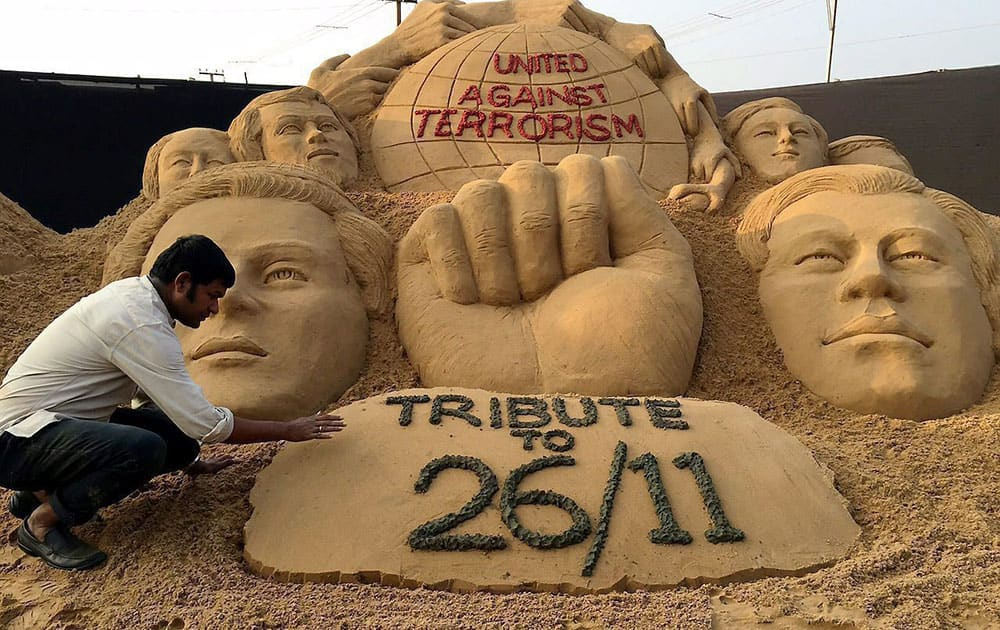 Sand artist Sudarsan Pattnaik pay tribute to 26/11 victims of Mumbai terrorist attack through his sand sculpture with message United against Terrorism at Cuttack in Odisha.