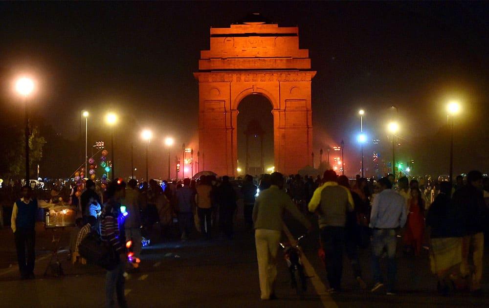 India Gate is illuminates in orange to raise awareness on ending violence against women in New Delhi.