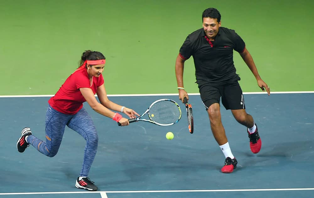 Tennis stars Mahesh Bhupathi and Sania Mirza during a mixed doubles exhibition match in DLTA complex, in New Delhi.