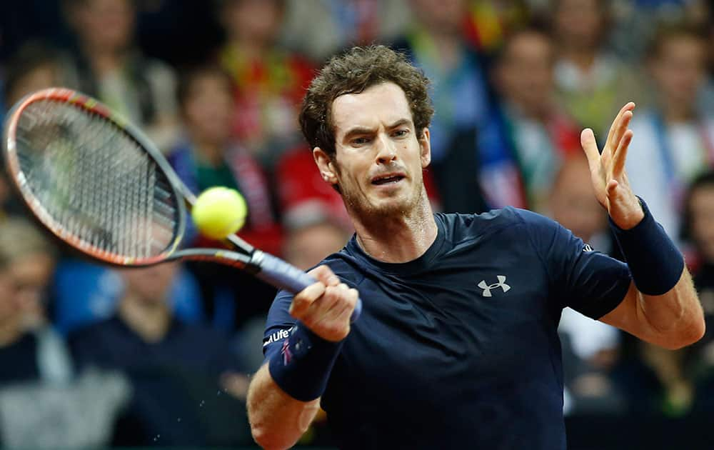 Britain's Andy Murray returns against Belgium's Ruben Bemelmans during their Davis Cup final tennis match at the Flanders Expo in Ghent, Belgium.