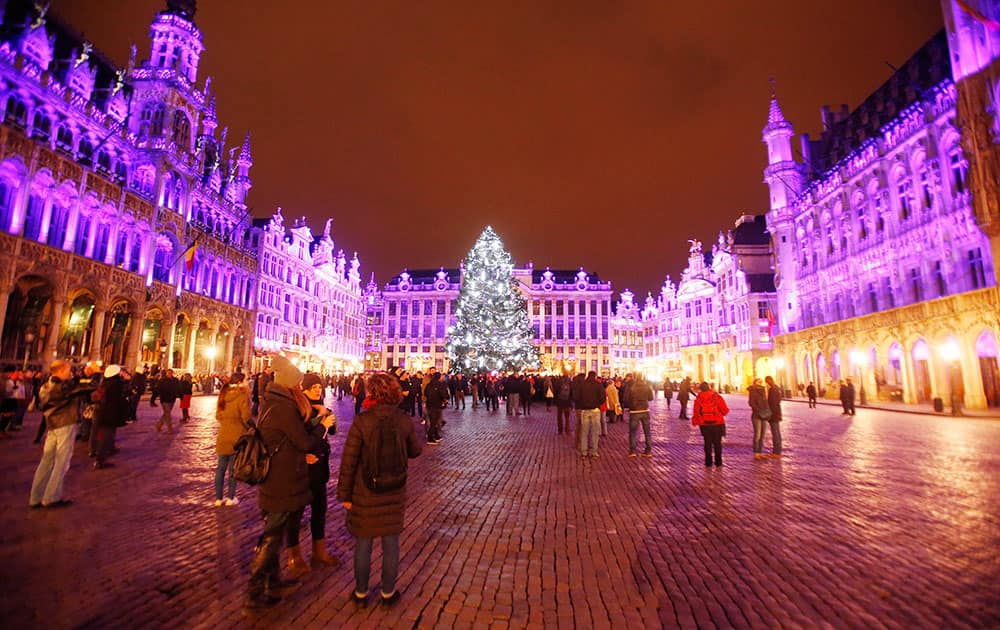 The buildings around the Grand Place are illuminated during the opening of the Christmas Market in Brussels, Belgium