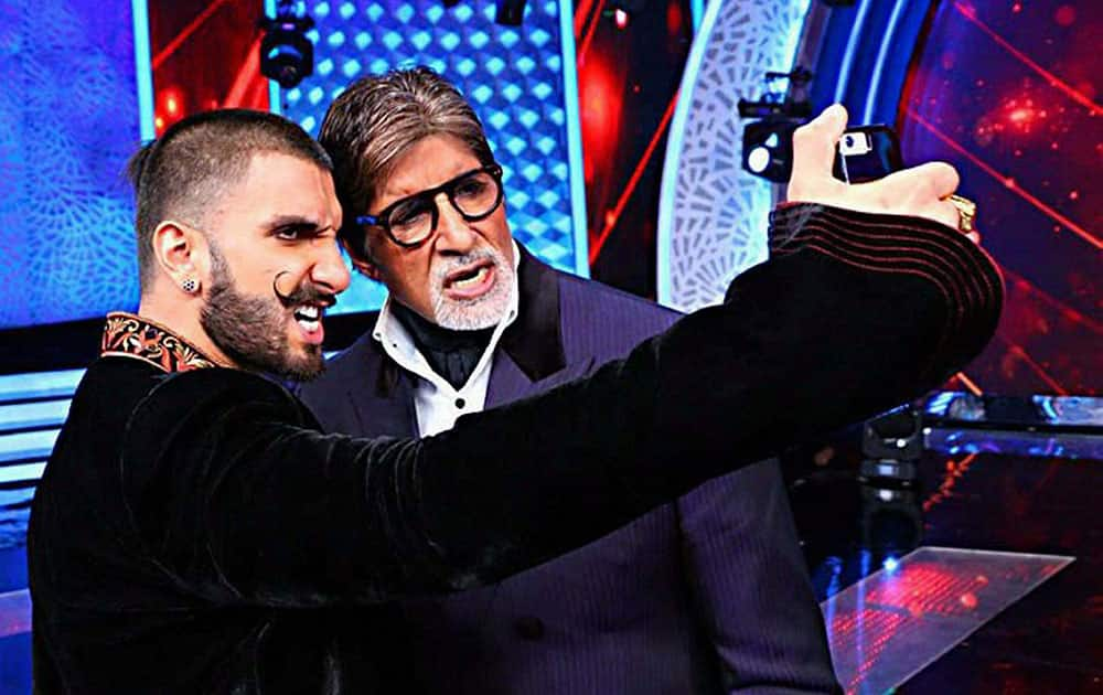 Bollywood actor Ranveer Singh takes selfie with Amitabh Bachhan during a television show in Mumbai.