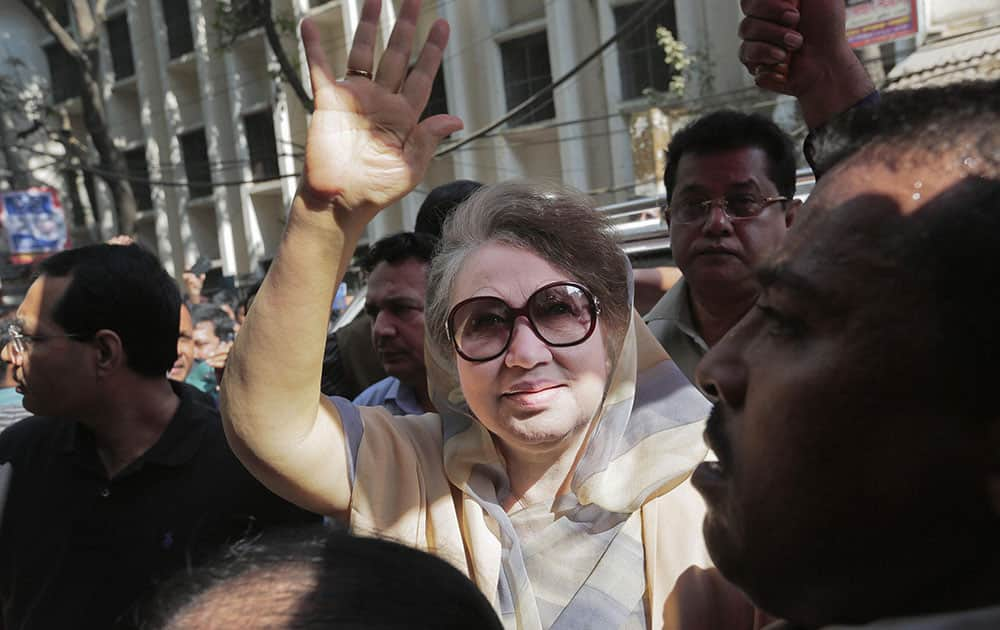Former Bangladeshi Prime Minister Khaleda Zia waves as she arrives for a court appearance in connection with a corruption case in Dhaka, Bangladesh.