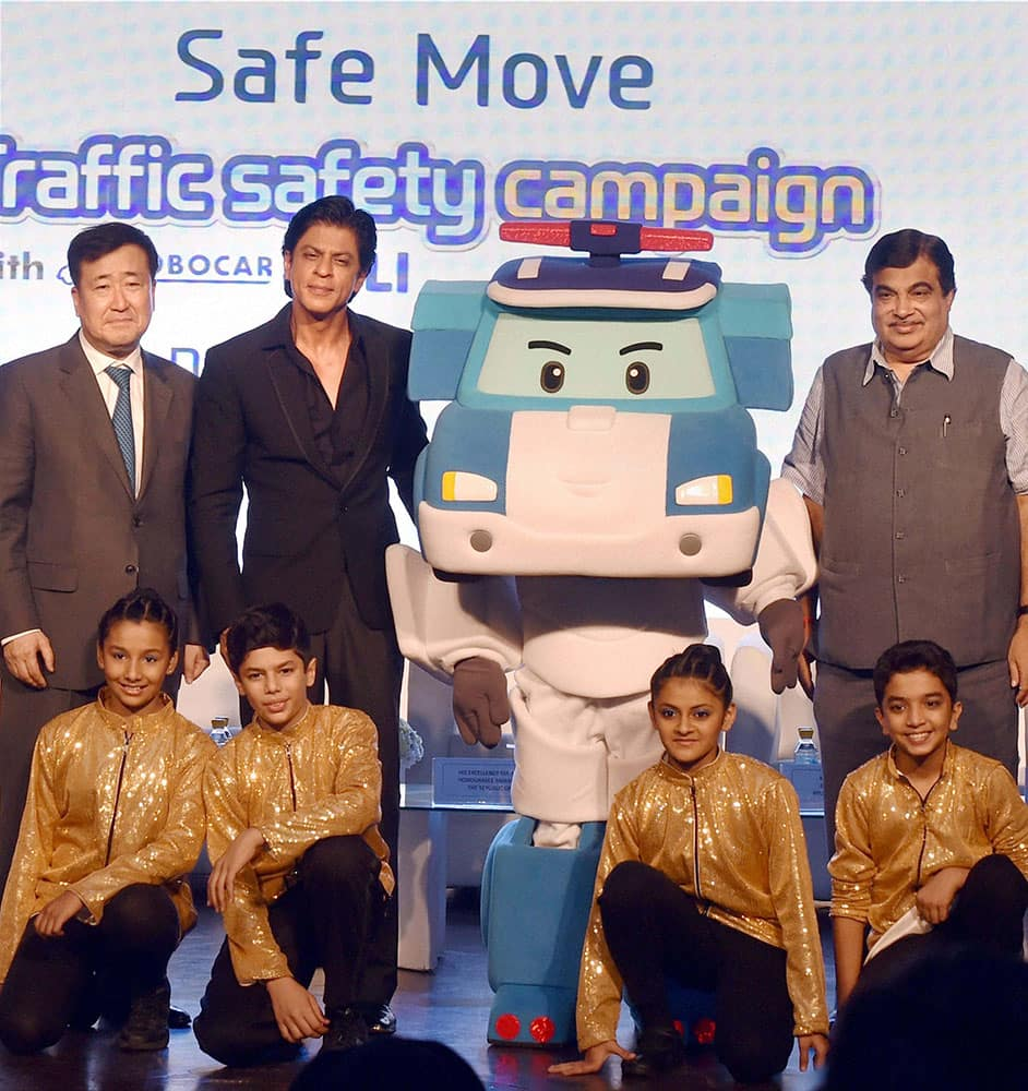 Transport Minister Nitin Gadkari with Bollywood actor and Hyundai brand ambassador Shahrukh Khan and Managing Director, Hyundai Motor India Ltd., Y K Koo pose with Mascot of the Hyundai India Safe Move campaign, Robocar Poli during the launch of the traffic safety campaign, in New Delhi.
