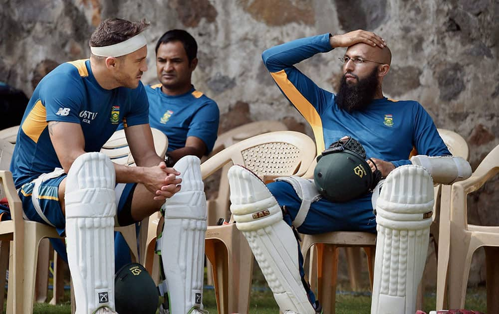South African captain Hashim Amla with teammate Faf du Plesis during a practice sesion in New Delhi on Tuesday ahead of the 4th Test match.