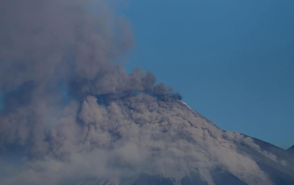 Volcan de Fuego or Volcano of Fire blows outs a thick cloud of ash as seen from Escuintla, Guatemala.
